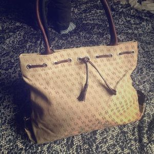 Skin and brown D&G bag